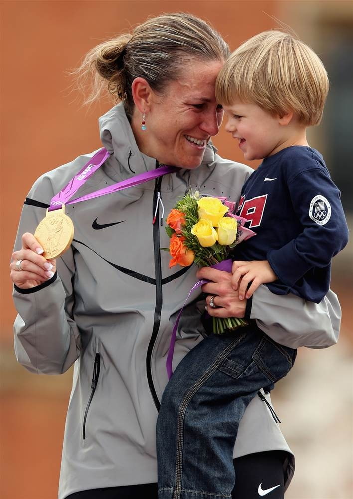 Gold medalist Kristin Armstrong of the United States celebrates with her son during the medal ceremony after the women's individual time trial road cycling. #Olympics #London2012