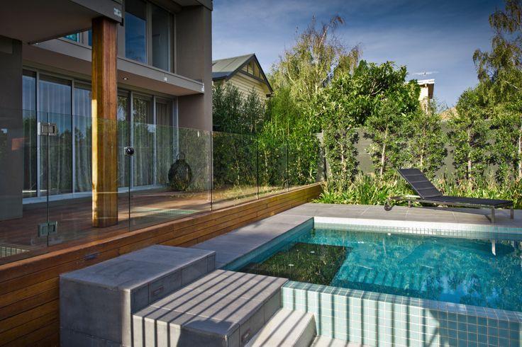 Concealed decking frameless glass pool fence