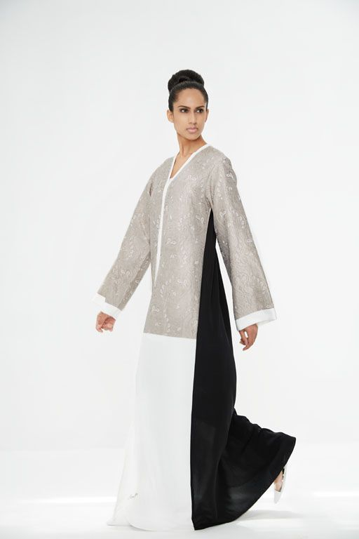 Arabesque kimono cut abaya with silk jacquard embellishment in combination with light crepe satin.