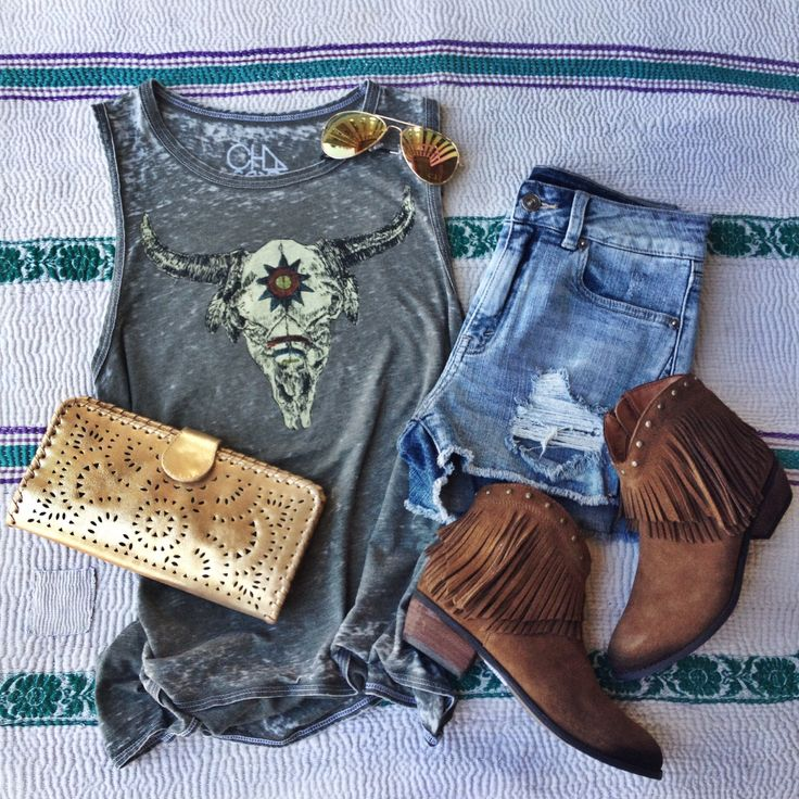 Every girl has to have an outfit that makes her feel like a rock star. This is that outfit. Graphic tee, steer skull, tank, fringe boots, Cleobella, cutoffs, festival style, summer outfit
