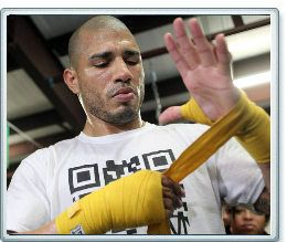 Miguel Cotto wrapping his own Hands - Photo - Boxing News
