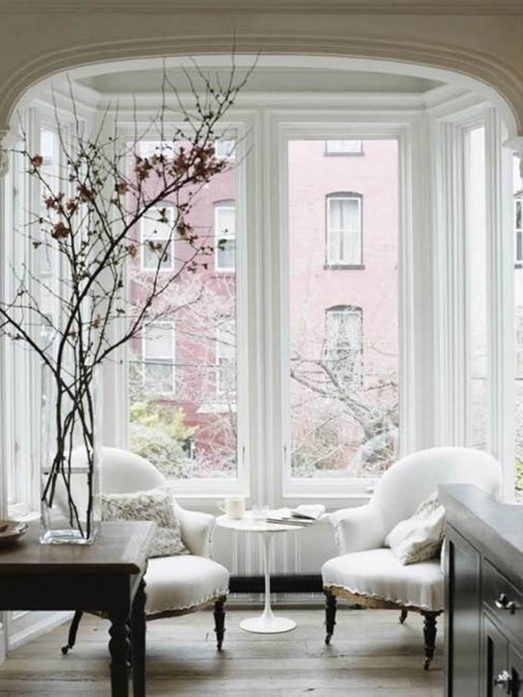 Bay Window Decorating Ideas. Note to self: If you live in a place that has cool weather, decorate everything in white on the patio or near the window.