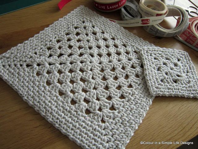 Simple granny square with a border.  Maybe use extra bulky yarn or rope and make…