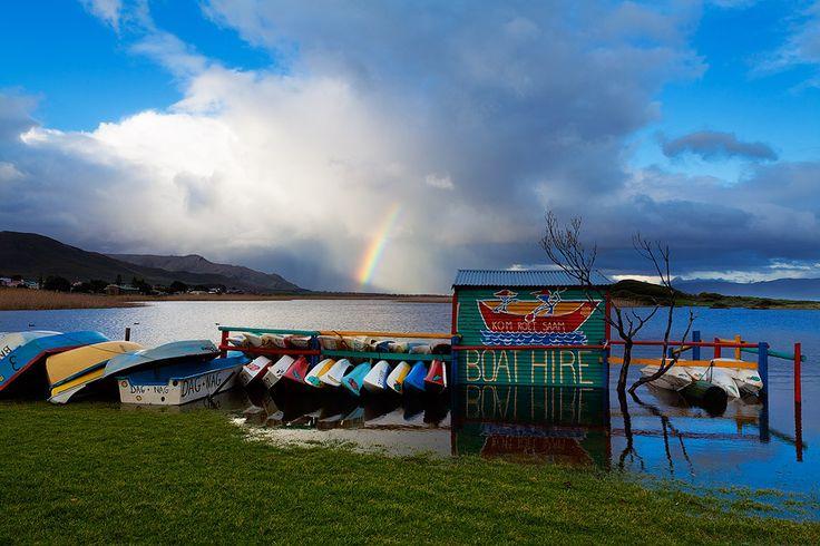 Kleinmond lagoon - boats at a flooded lakeside - Cape's Whale Coast - South Africa  #kleinmond #whalecoast #southafrica