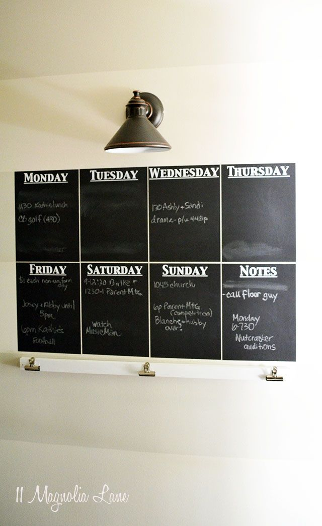 DIY horizontally striped wall and a #chalkboard week at a glance wall calendar create a family #organization center.