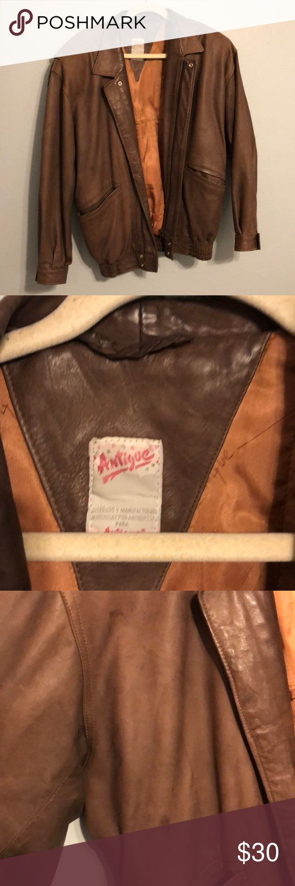 Vintage brown leather jacket This brown real leather jacket has been very well loved. Super soft and worn in has a few spots on front as pictured but still very wearable. Elastic around waist, front and inner pockets. Shoulder pads and zip front closure. Very top gun style! antigue Jackets & Coats