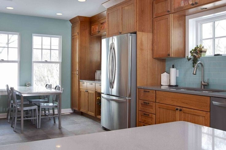 a more modern look with oak cabinets. stainless steel appliances