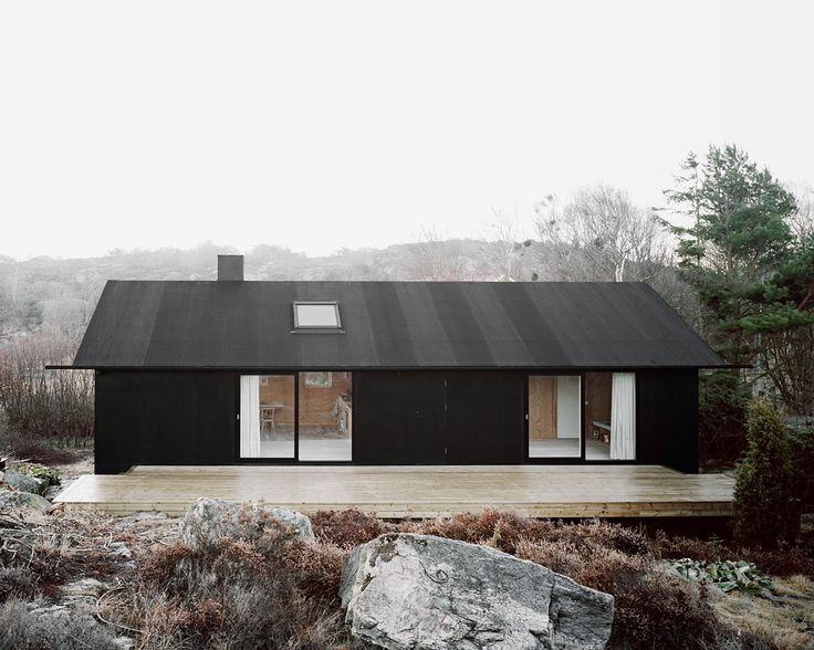 Complete renovation of a former summer house located on an island outside Gothenburg. Exterior cladding in tar coated plywood.