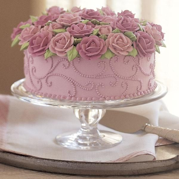 Brimming With Roses Cake - The world's favorite flower is celebrated in all its glory, underscored with graceful dotted scrolls. Watch our o...