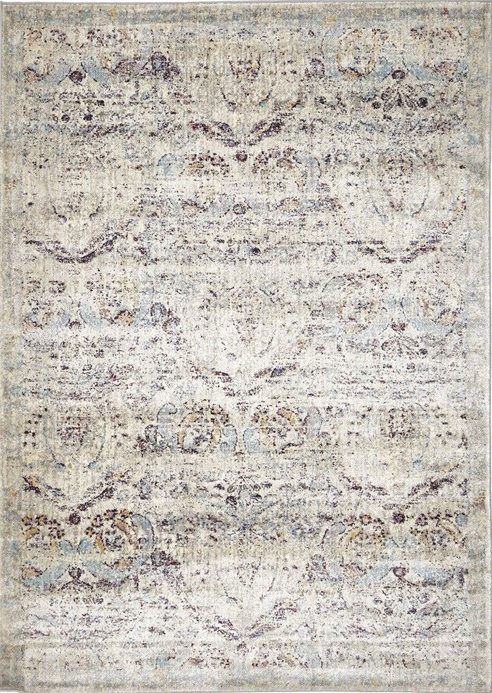 Zadar is a grey transitional rug featuring an ornate lotus motif in blue