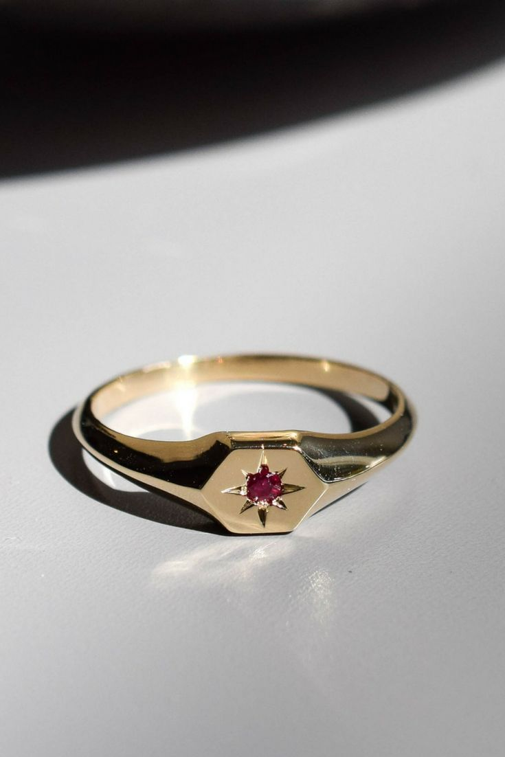 The beginning of your story; a constellation of precious moments. The Astrale Ring in 14k yellow gold features an hexagon at the center of which a star - your birth stone - glows. A personalized piece of jewelry to wear proudly or offer as a gift. myeldesign.com