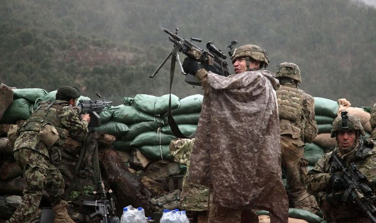 U.S. Soldiers with 2nd Battalion, 327th Infantry Regiment, 101st Airborne Division return fire during a firefight with Taliban forces in Barawala Kalay Valley in Kunar province, Afghanistan, March 31, 2011.