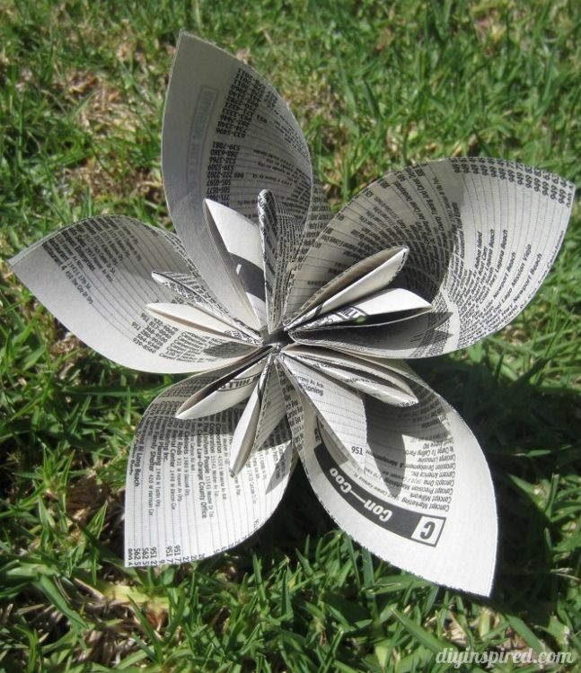 Ever wonder what to do with an old phone book? Repurposed Phone Book Page Origami Flowers