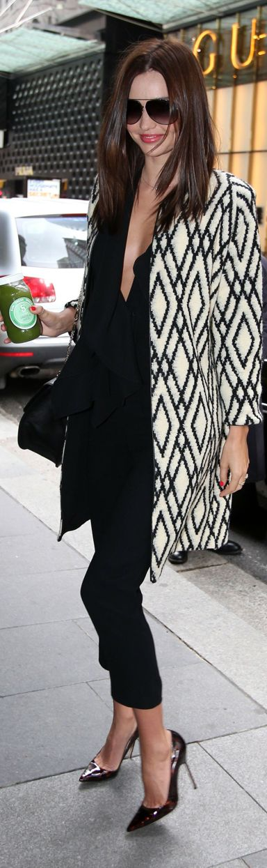 Street fashion black and white printed coat.