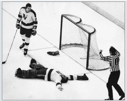 The Minnesota North Stars' Gump Worsley is probably best remembered for being one of the last NHL goaltenders to play without a mask (this photo, taken after a puck-to-the-head knocked out the Gumper during a game in 1972...only in MN