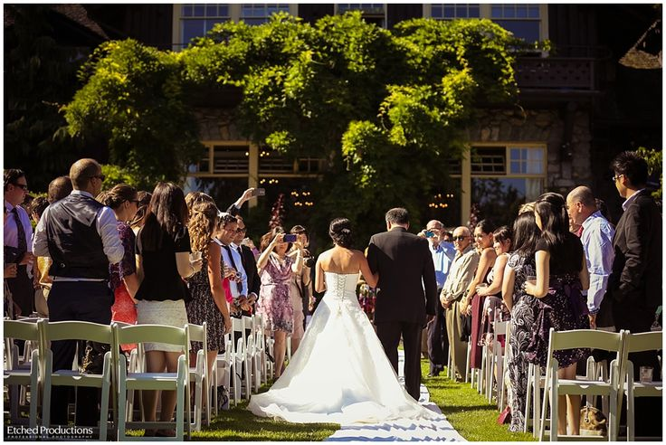 Bride walking down the isle at Stanley Park Pavilion Wedding. Photographed by Chuck Hocker of Etched Productions.
