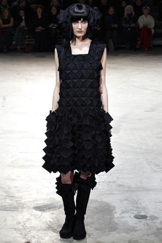 Origami squares as embellishment within the fabric plus a full extended drop waist skirt belies convention and logic of soft materials.  Yohji Yamamoto Fall 2013 Ready-to-Wear Collection Slideshow on Style.com