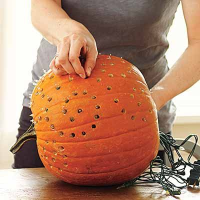 Create a twinkle lights pumpkin - Drill holes in a hollowed-out pumpkin, insert a strand of Christmas lights