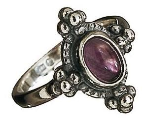 STONE TREASURES RING  Material: silver  Stone: amethyst or rock crystal