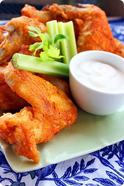 Buffalo Wings - I use Hooters Wing Sauce, but I like to bake them. I put a packet of Ranch dressing mix and the 3/4 cup of flour in a gallon bag. Throw in wings and mix up. Refrigerate for an hour. Place in pan, pour wing sauce over and cook 20 minutes each side.