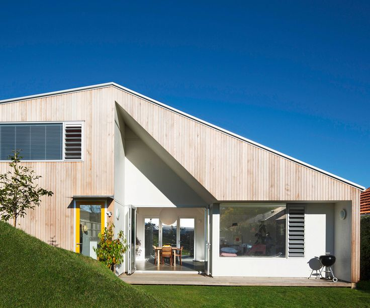A young couple re-imagines suburban back-section living with a compact optimistic new home.