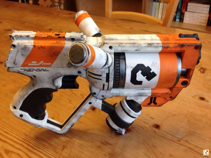 This was a piece done up for Orange Mod Works, a company that produces after-market upgrades to NERF blasters. Description from therpf.com. I searched for this on bing.com/images