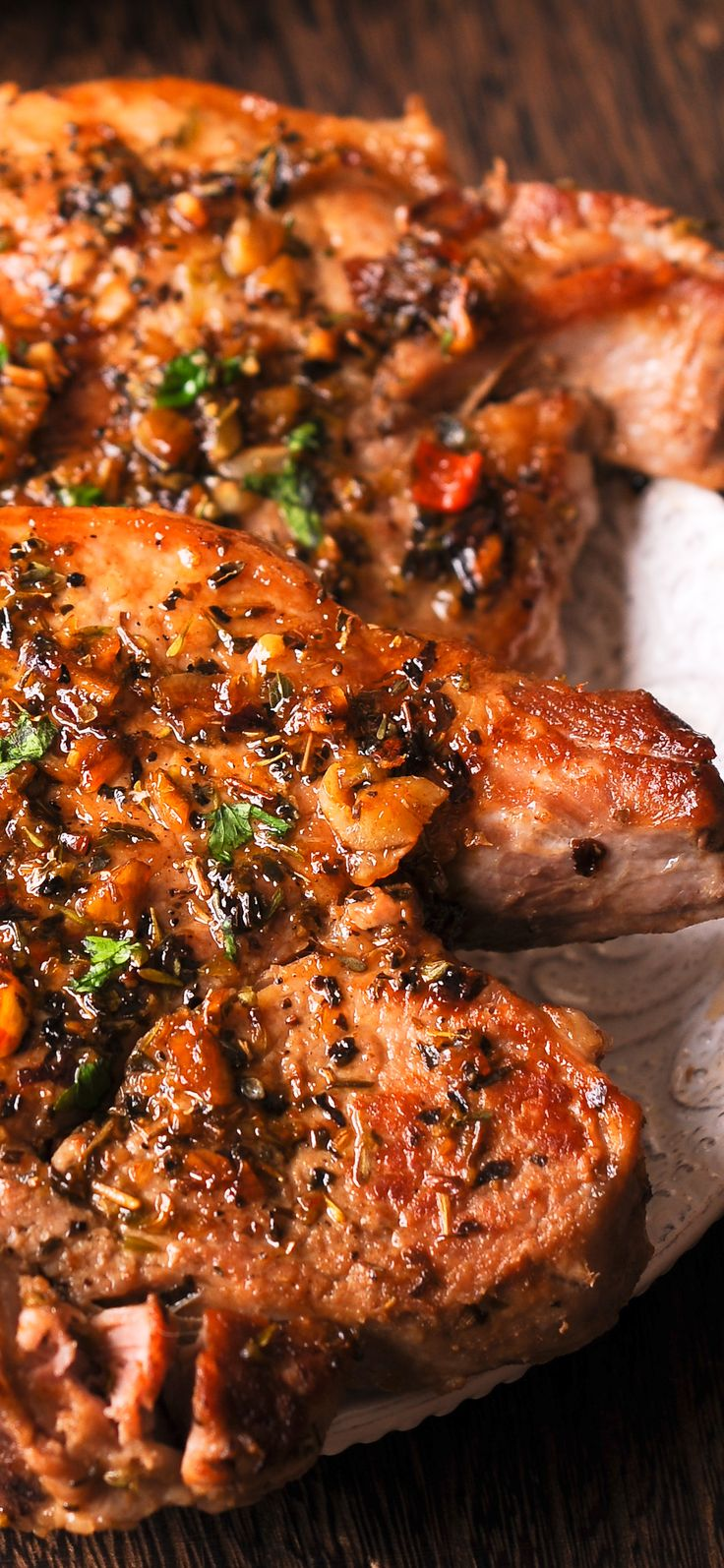Pork Chops in garlic, herbs, brown sugar and wine sauce
