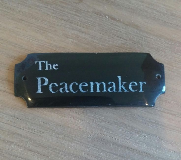 """This will be the nameplate for """" The Peacemaker """" piece, it is a piece of buffalo horn."""