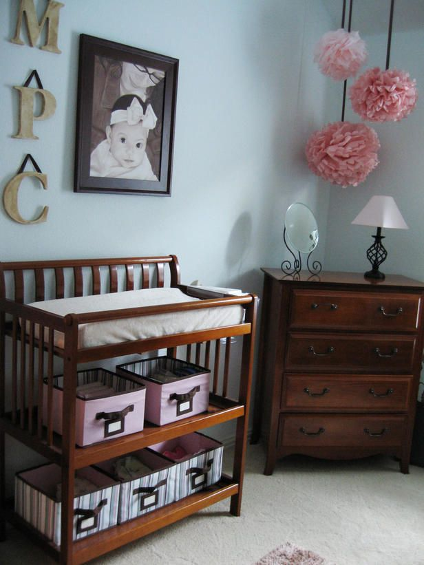 """""""A changing table requires lots of accessible storage within arm's reach. Try keeping diapers opened and stacked in a basket or drawer. This makes it easy to grab just one."""""""