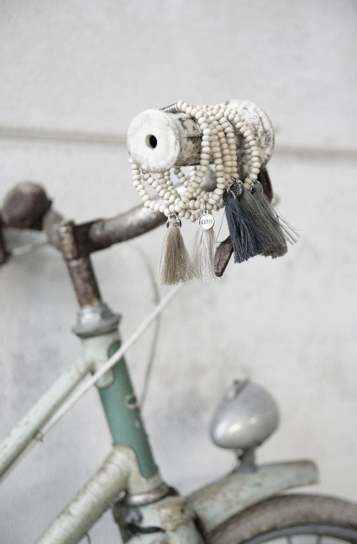 I like the incongruity of displaying the bracelets on the bike handle. Could recreate this, or do one with jewelry looped over a violin bow, on a baseball bat, etc.