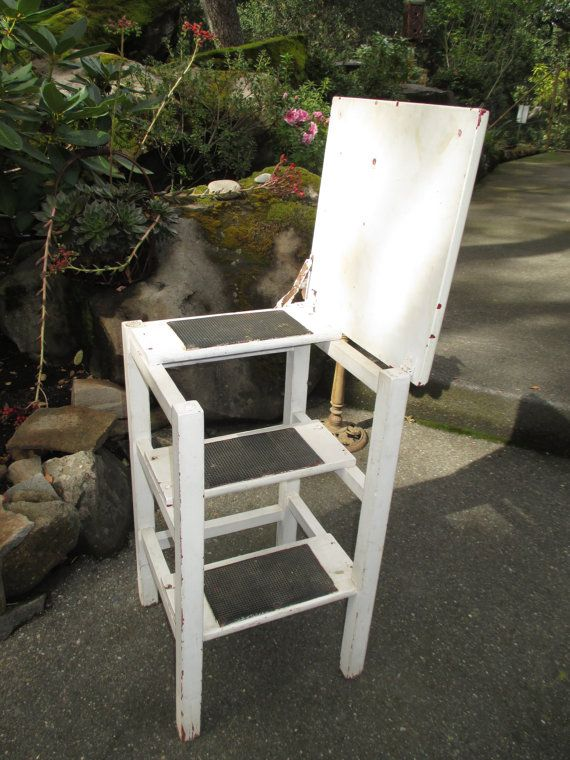 This wonderful solid wood, vintage stool - step stool - step ladder, features a hinged fold up seat to reveal a 3-step stool/ladder. The steps