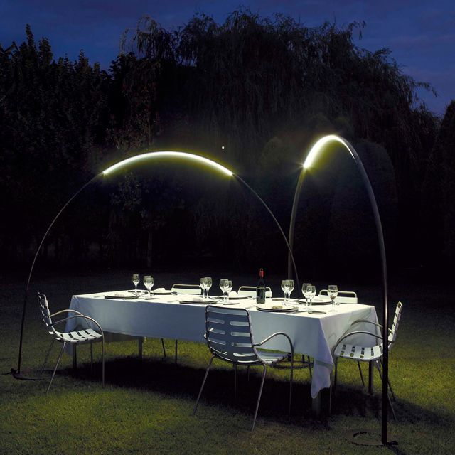 """""""Inspired by Halley's Comet, this light has an semi-circle shape with a built in LED Light Strip so as to bathe outdoor dining or seating in warm light. The fixture is waterproof."""""""