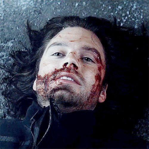 He looks as if, for a moment, he's laying in the snow again, the pain from his missing left arm so great, that it was numbing.  He looks like he's watching the train leave him behind once more.