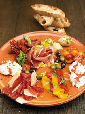 Bring out this gorgeous antipasti plate before dinner and guests will be fighting over it