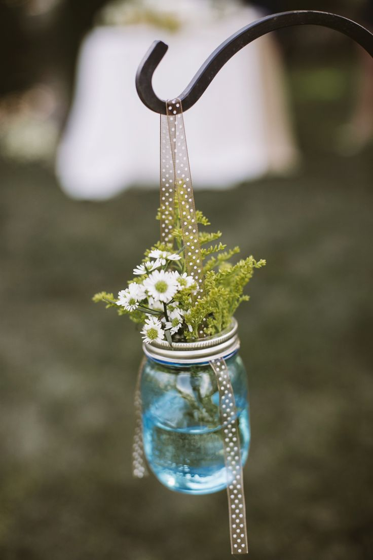 hanging flowers in mason jars // photo by Love Me Do Photography // http://ruffledblog.com/handmade-new-jersey-wedding