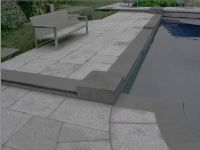 #Enhanced #GranitePaving and Pool Coping Tiles. A border has been created in this granite paving, by using an enhancing sealer on the coping tiles