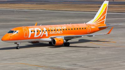 Fuji Dream Airlines FDA (JP) Embraer ERJ -175 JA05FJ aircraft, skating at Japan Nagoya Komaki Airport. 25/03/2016. (The Orange colored plane).