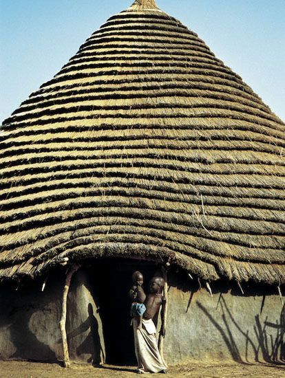 DINKA CHILDREN IN FRONT OF A THATCHED HUT - ©Angela Fisher and Carol Beckwith Modernbook Gallery: