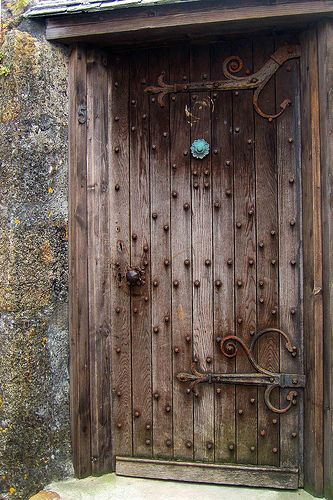 Ran across this interesting old door while walking the streets of St. Ives, Cornwall, England. Please double click on the image to view on black. by Jim Johnson