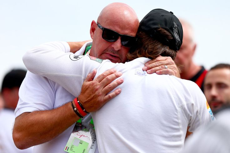 Fernando Alonso Photos - Fernando Alonso of Spain and McLaren Honda comforts Jules Bianchi's father Philippe Bianchi after the family and drivers formed a huddle around the drivers' helmets, including the late driver's, and observed a minute's silence before the Formula One Grand Prix of Hungary at Hungaroring on July 26, 2015 in Budapest, Hungary. - F1 Grand Prix of Hungary