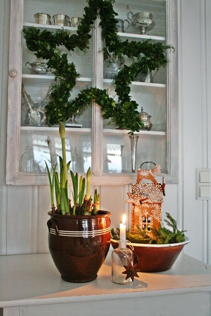 Make star from yardstick and wrap with garland
