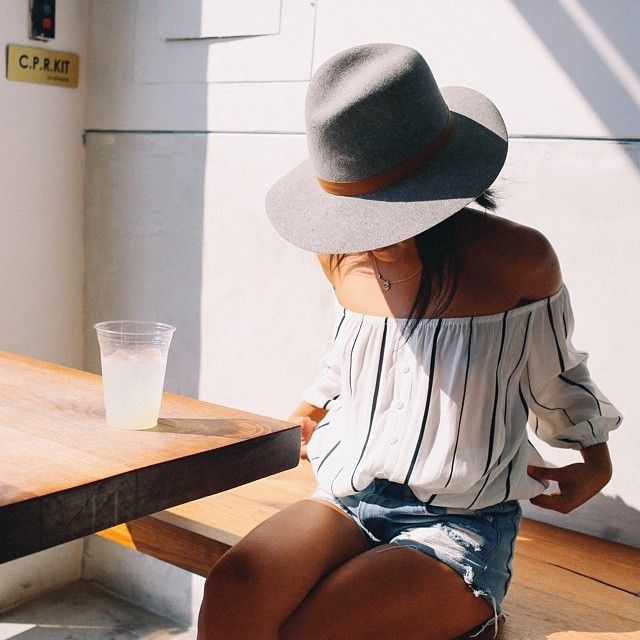 Summer perfection. Wide Brim, off the shoulder stripe top + cut offs.