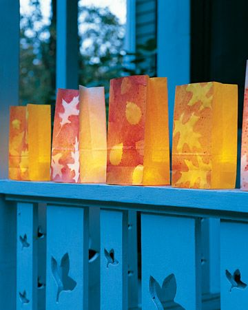 Autumn Luminarias: These luminarias are perfect for lighting the way to your front porch, on Halloween or for any fall party. How-To: 1. Collect fallen leaves, and arrange them on top of colored-paper treat bags. 2. Put 1 teaspoon acrylic paint (choose colors that contrast with bags) in a 2- to 3-ounce misting bottle. Fill halfway with water and shake to mix. Mist bags and leaves. Let dry 20 minutes. Remove leaves. Repeat on other side. Fill bottom of each bag with sand. 3. Illuminate: For…