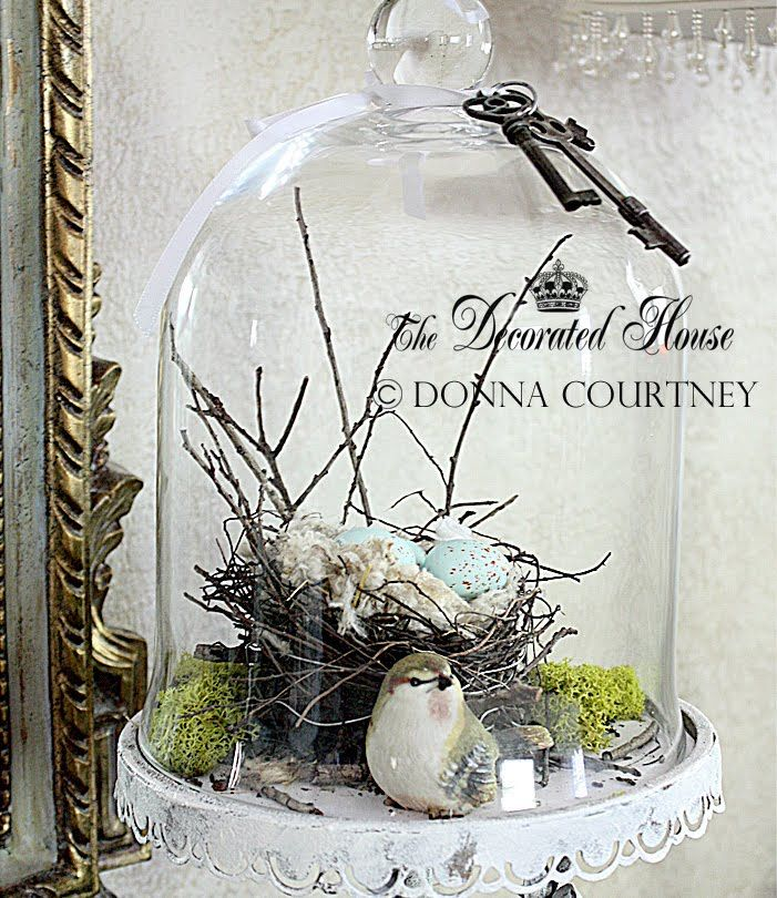 The Decorated House ~ Spring 2012 cloche - bell jar with natural found nest, moss and a little bird inside, with 3 antique skeleton keys on top.