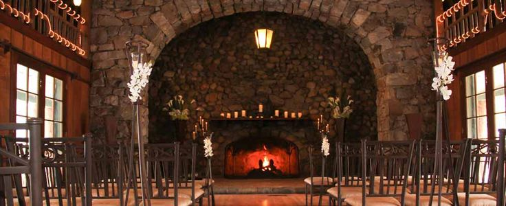 The massive fireplace at the end of the grand hall is a beautiful backdrop to your wedding. http://lakefrontwedding.com/lake-tahoe-wedding-venues/lake-tahoe-wedding-historic-lakefront-estate/