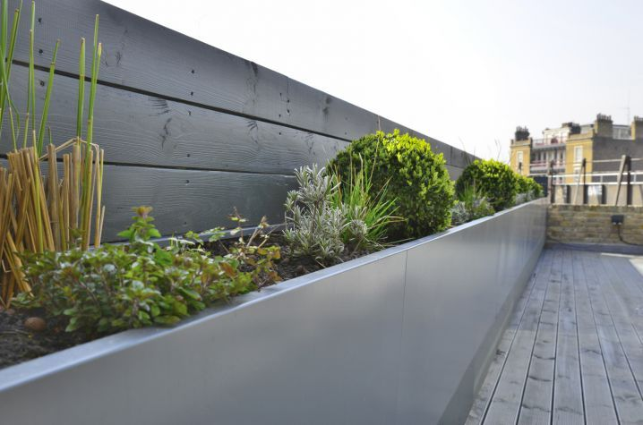 The planters were powder coated to RAL 7011 [Iron grey].