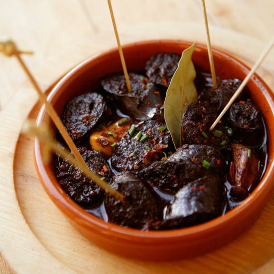 Chorizo Poached in Red Wine | This smoky Spanish sausage with garlic is cooked gently in red wine until it's plump and juicy.