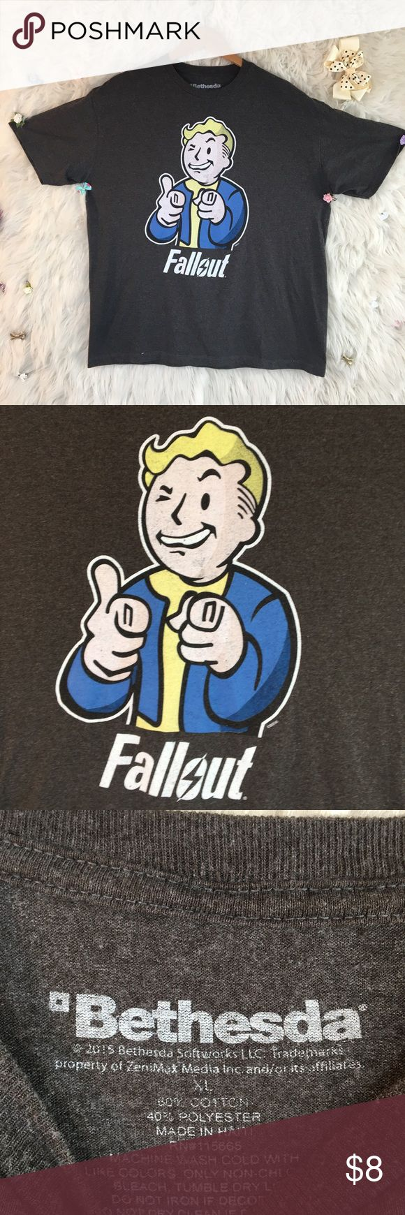 FALLOUT PIP BOY T SHIRT GRAY WITH BLUE AND WHITE Great gift for your gamer guy. Logo is cracking a bit but all in all good used condition . ⬇️⬇️⬇️  PLEASE READ  Any clips/ accessories you see in the photos aren't included UNLESS otherwise stated.   If you aren't familiar with a particular brands sizing and I did not include a size chart, comment below and I'll gladly provide info. bethesda Shirts Tees - Short Sleeve