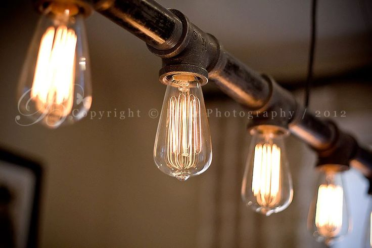 Industrial track lighting with Edison bulbs. Totally going to toss the builder basic for this!!