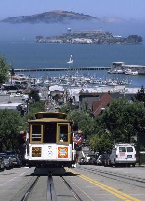 San Francisco's cable car with Alcatraz beyond.Photo: Holger Leue